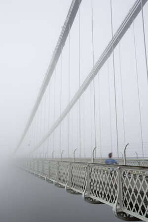 suspension: Running into the void - Clifton Suspension bridge in the early morning mist