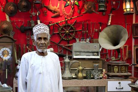 souk: Muscat, Oman - March 26, 2013  Unidentified Antique dealer in Mutrah Souk