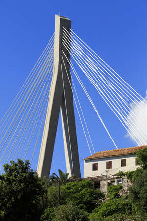 Cable stayed bridge with house in Dubrovnik photo