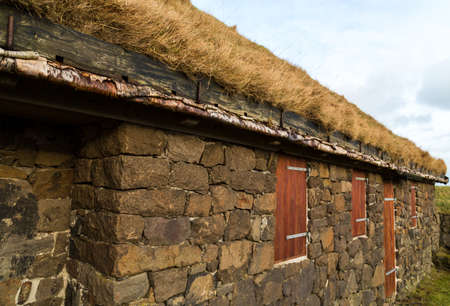 rafters: Typical rural building with natural grass roof and silver birch rafters in Torshavn Faroe Islands Stock Photo