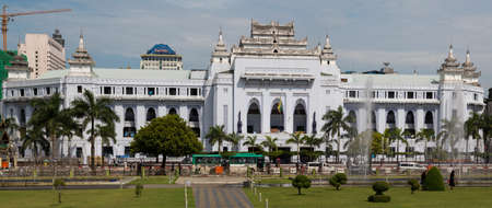Yangon, Myanmar, 8 Nov 2015. The City Hall is a prominent building mixing colonial and indigenous symbols, such as a peacock