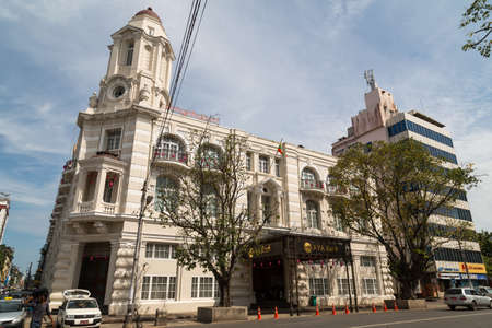 harrods: Yangon, Myanmar, 8 Nov 2015. The former Immigration Department, then a department store, the Harrods of the East, now it hosts the AYA bank next to City Hall