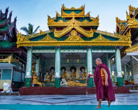 Yangon, Myanmar, 9th November 2015: A monk walking to pray at the Shwedagon pagoda Editorial