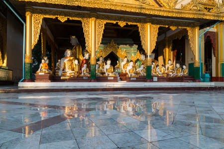 A beautiful temple, reflected in puddles after heavy rain at Shwedagon pagoda