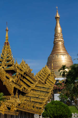 The Shwedagon pagoda showing the highly decorated covered approach - portrait landscape Standard-Bild