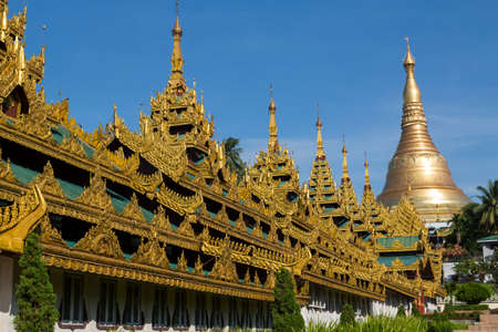 The Shwedagon pagoda showing the highly decorated covered approach - landscape Standard-Bild