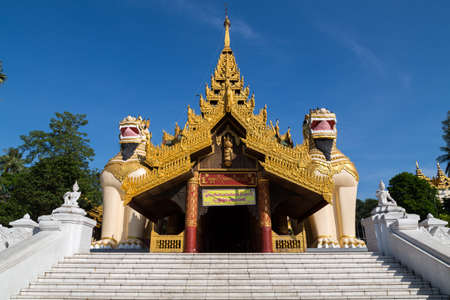 guarded: Entrance to the Shwedagon pagoda, guarded by two Chinthe