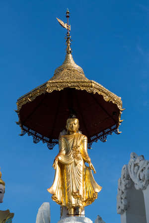 Beautiful gold statue on top of one of the temples at the Shwedagon pagoda in Yangon