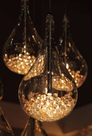 original lighting of several glass chandeliers photo