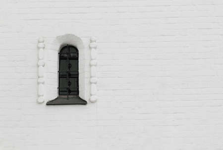 interdict: barred a narrow window in the brick thick wall