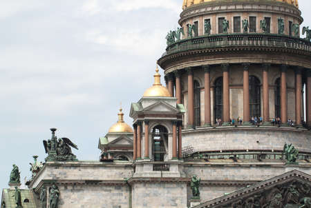 The dome, colonnade and a statue of St. Isaacs Cathedral, St. Petersburg