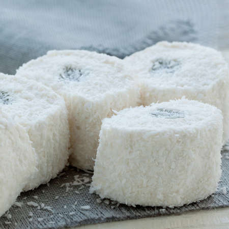 appetizing white Turkish Delight in a coconut crumb