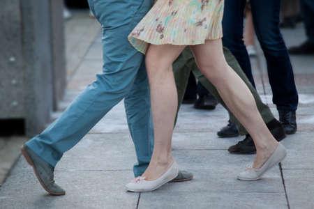 Girl and boy dancing tango on the dance floor