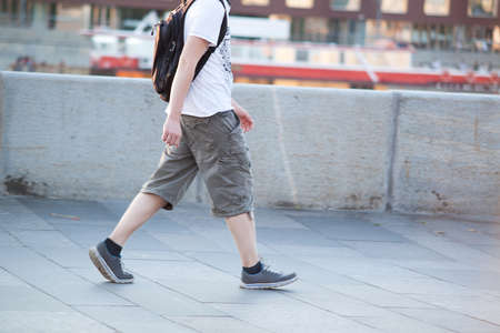 modern boy is walking around the summer city