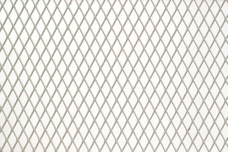 white metal grating with fine diamond-shaped cells