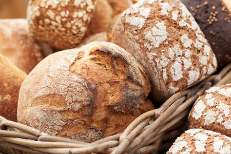delicious fresh loaves of rye and wheat bread to lie in a basket in a shop window or in a bakery