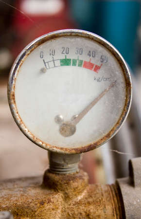 compression tank: Rusty Air compressor meter Stock Photo