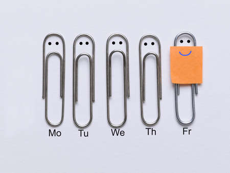 Row of clips appearing sad faces except the corresponding clip smiley face that has come the weekend Stok Fotoğraf - 34021335