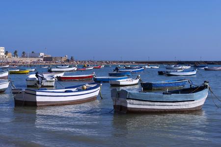 cadiz: Fishing boats. The beach and the background creek. Cadiz, Spain