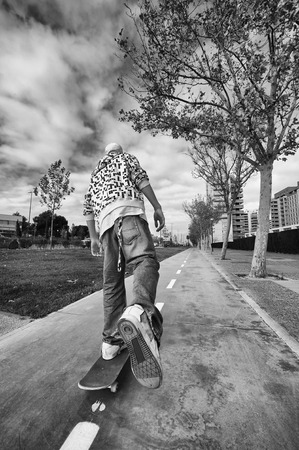urban culture: Boy 16 years skating down the street