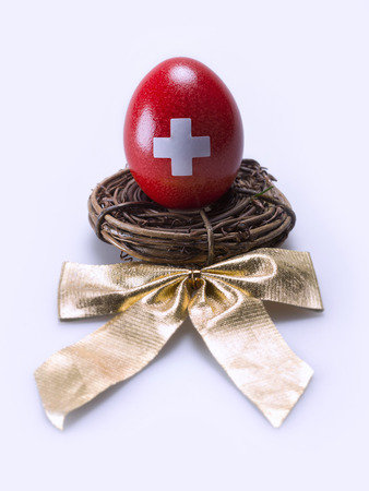 swiss culture: Egg painted red with a white cross Stock Photo