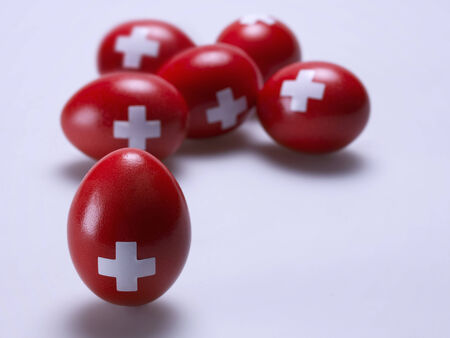 swiss culture: Eggs painted red with a white cross