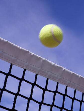 passing over: Close up of a tennis o paddle ball, passing over the net Stock Photo