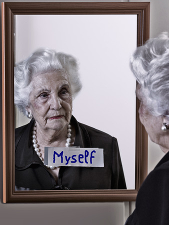 looking in mirror: Alzheimer\\\\ Stock Photo