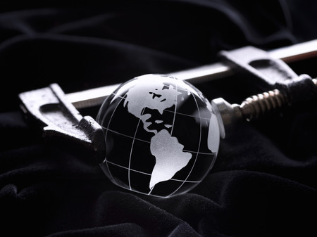 Glass globe, pressed by a clamp (tool) Stock Photo