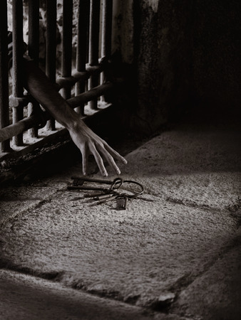 convict: Prisoner reach for the key Stock Photo