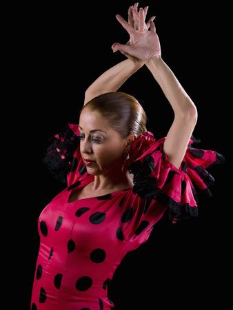 Las mujeres, vestidas con el baile flamenco