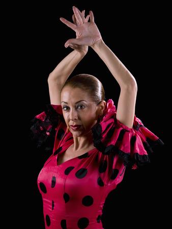 bailando flamenco: Mujer bailando flamenco, mirando a la c�mara Foto de archivo