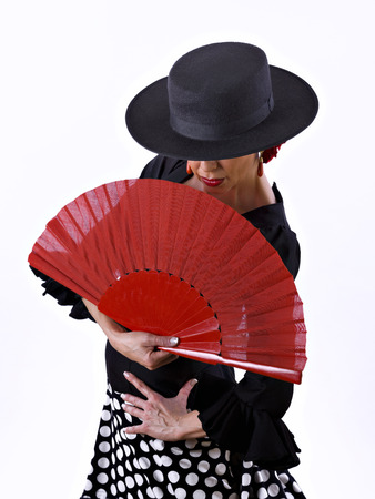40 44 years: Male, flamenco dress with a hand-held fan, on white background