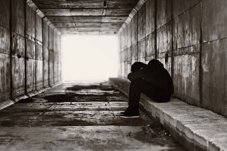 Silhouette of a boy in a tunnel photo