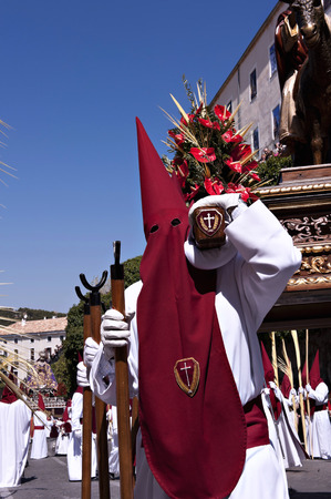 penitence: A group of bearers (called Costaleros) carrying a religous float (known as a Tronos) in the processions held there to celebrate Semana Santa (Easter Holy Week)