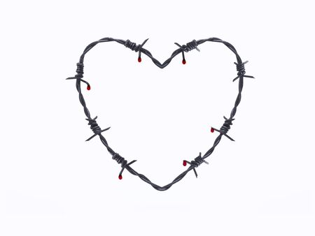 Barbed wire in heart shape photo