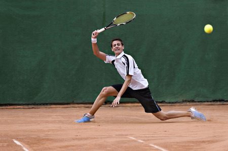 man with long hair: Young, playing tennis Stock Photo
