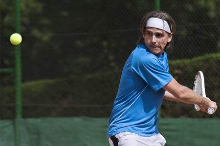 tennis balls: Young, playing tennis Stock Photo