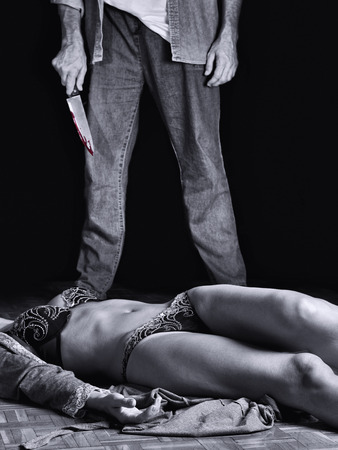 Dead woman with the murderer carrying a knife photo