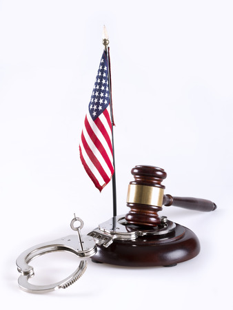 criminal activity: Gavel, handcuff and American flag Stock Photo
