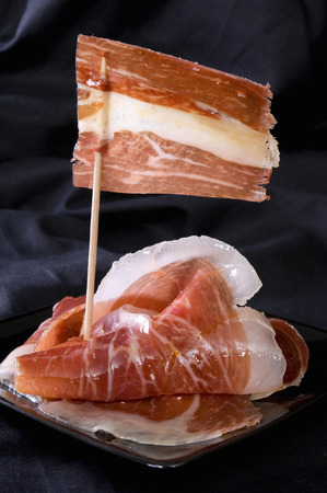 aperitive: Spanish ham, called Iberico, with a flag done with a slice