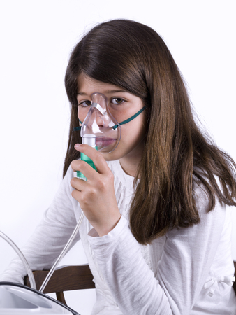 11 years: Young applying a mask for asthma Stock Photo