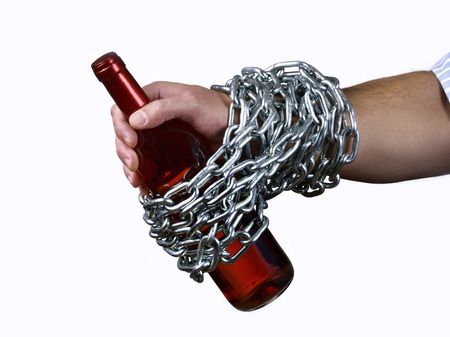Hand man, chained to a bottle of wine Stok Fotoğraf