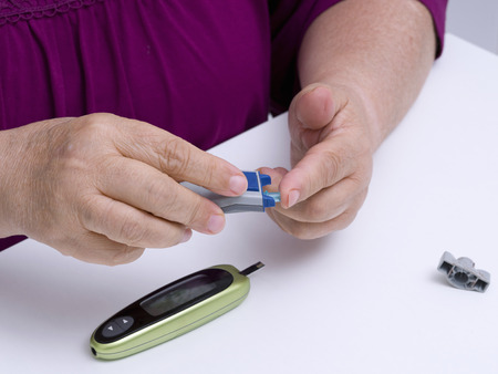 Doing patient diabetes blood test glucose level using glucometer Stok Fotoğraf - 36860539