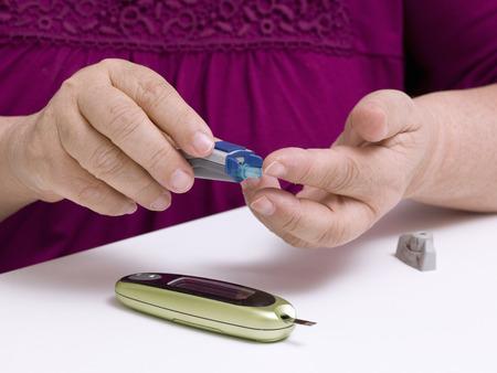 Doing patient diabetes blood test glucose level using glucometer Stok Fotoğraf