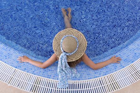 waterpool: woman relaxing in an outdoor waterpool
