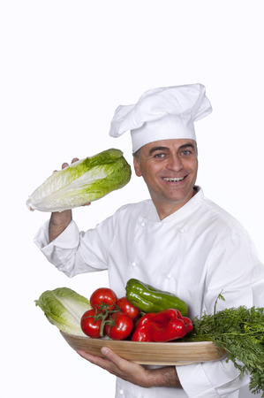 Chef with vegetables, smiling at the camera Stok Fotoğraf - 38156193