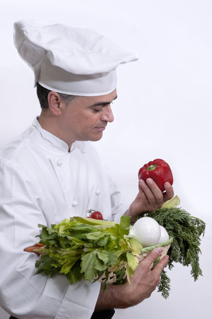 Chef with several vegetables in the hands Stok Fotoğraf - 38156197