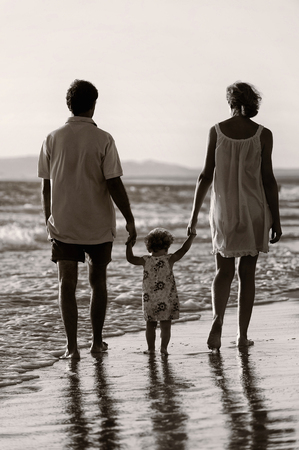 Family walking on the beach in sunset Stok Fotoğraf - 38156386