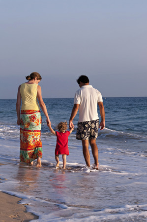 Family walking on the beach Stok Fotoğraf - 38156432